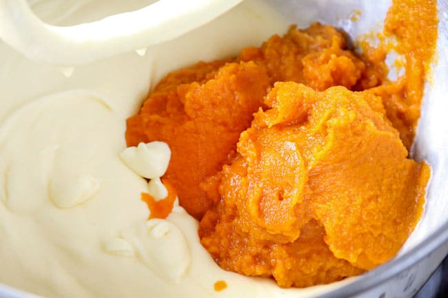 showing how to make pumpkin spice cake recipe by adding pumpkin to egg mixture