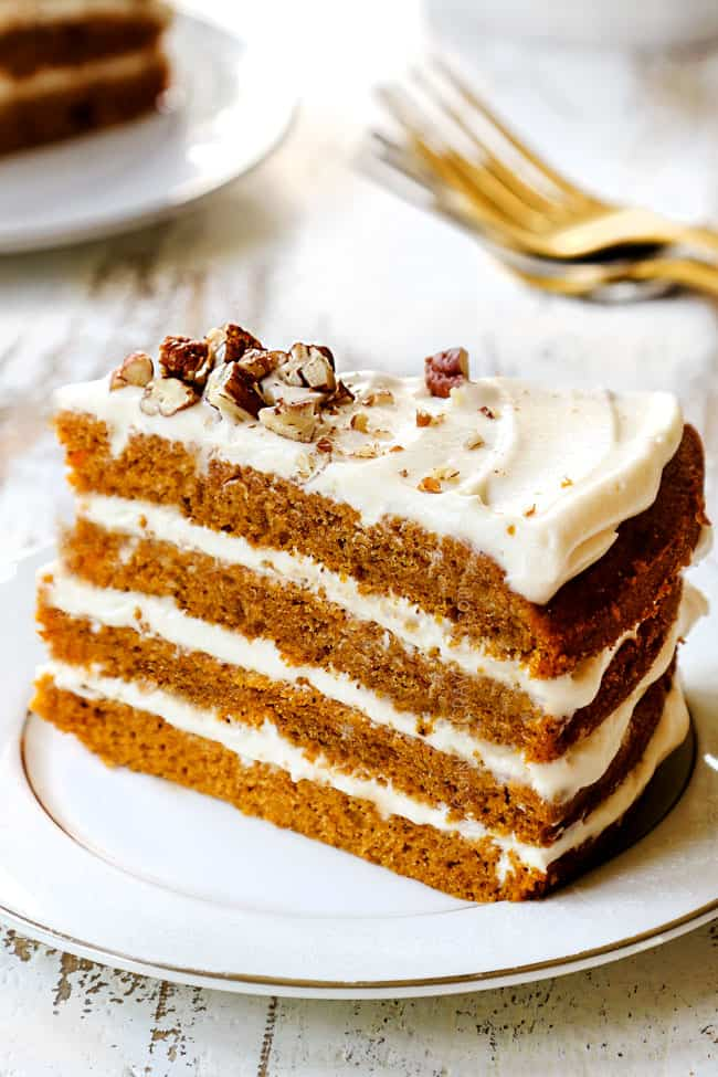 up close of a slice of pumpkin spice cake on a white plate
