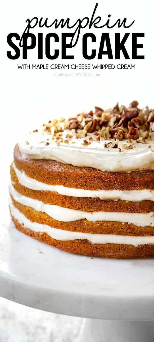 pumpkin spice cake on a pedestal showing the side view of the cake with 4 layers