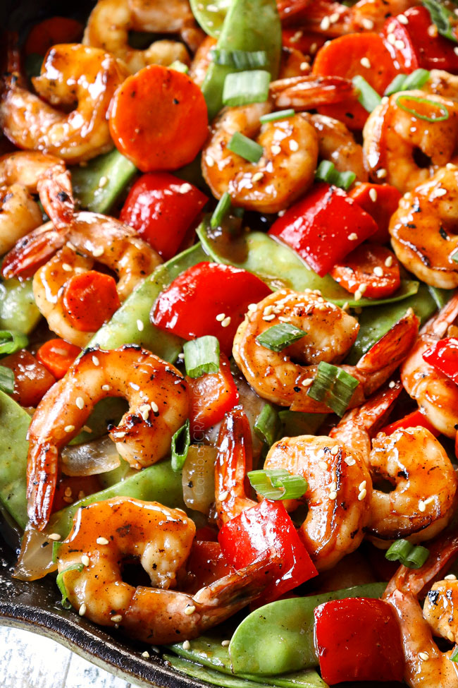 up close side view of shrimp stir fry in a skillet
