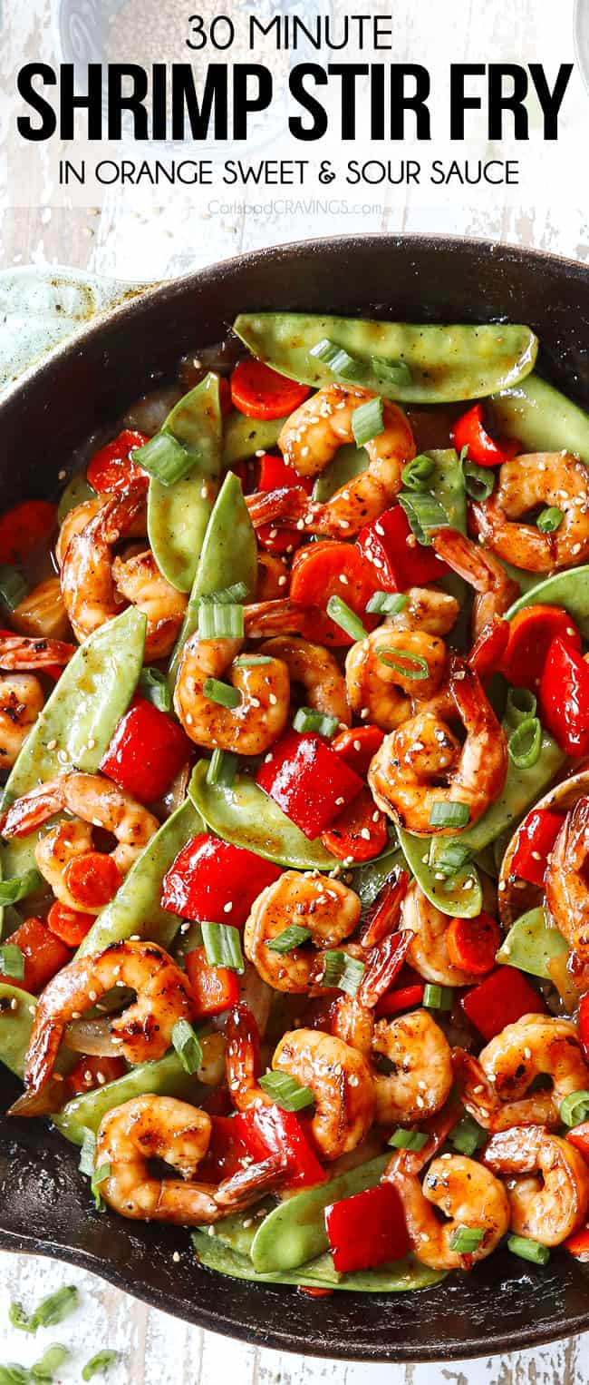 top view of shrimp stir fry recipe in a skillet garnished by green onions