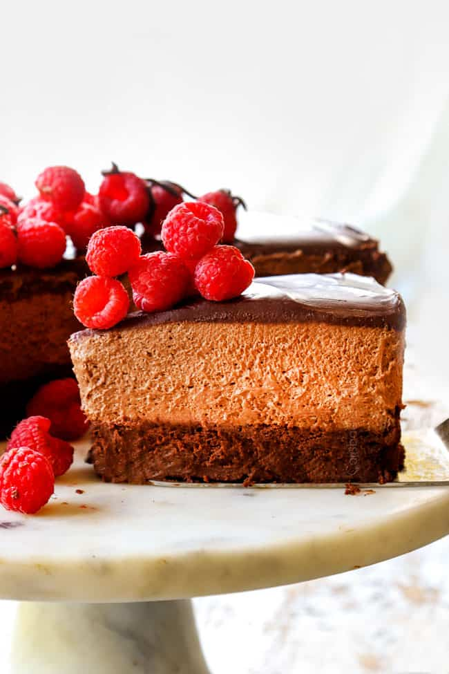 a slice of Chocolate Mousse Cake recipe on a white pedestal