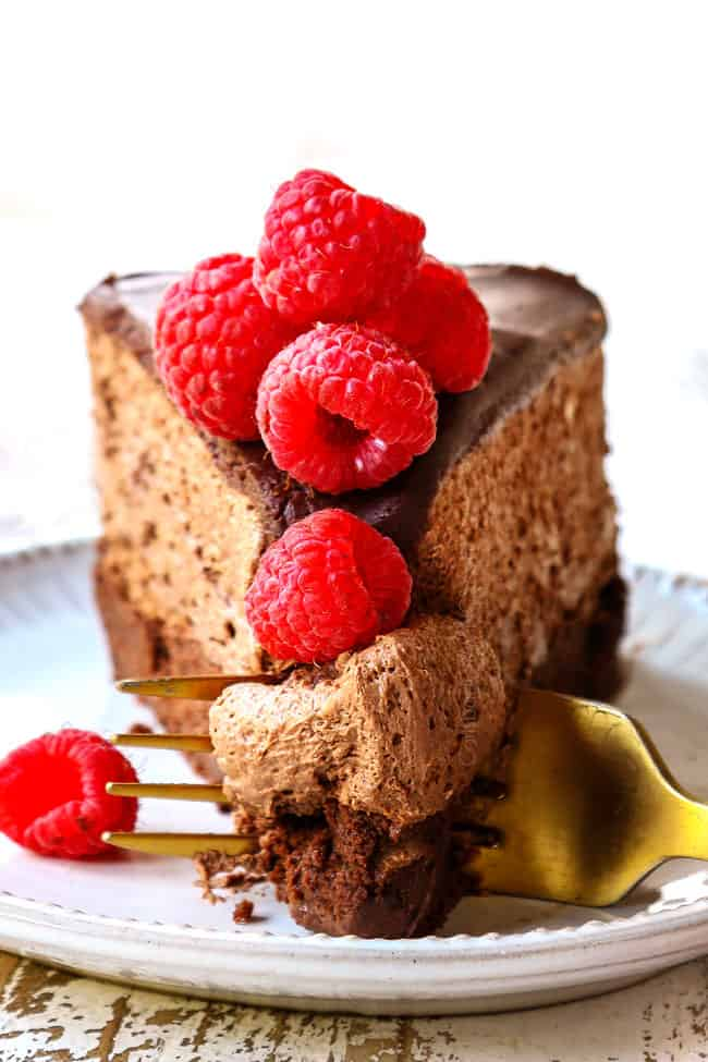 up close front view of a slice of Chocolate Mousse Cake recipe with a fork taking a bite