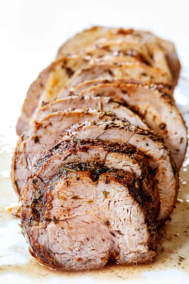 front view of slow cooker pork loin sliced, showing how juicy it is