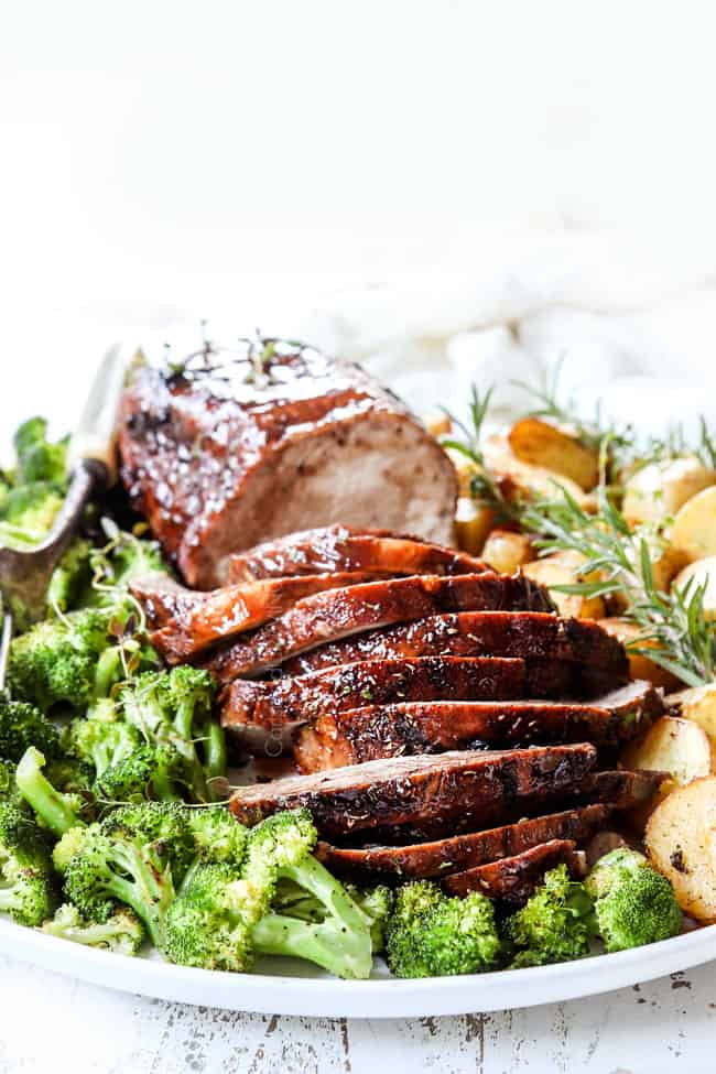 crockpot pork loin recipe sliced on a platter with broccoli anad potatoes