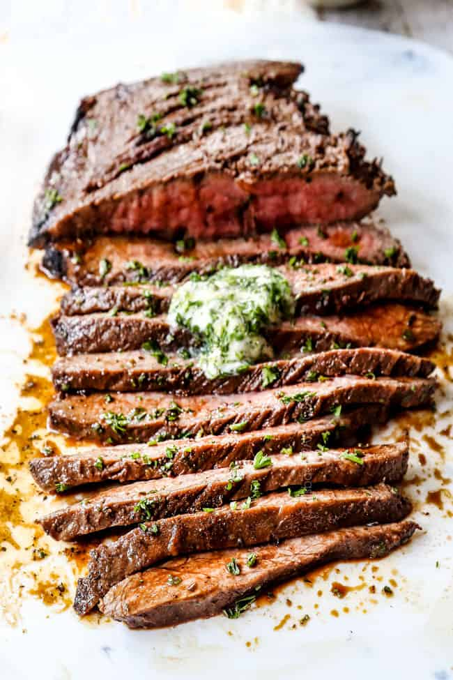 up close front view of London Broil recipe cut into juicy slices