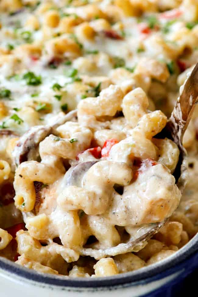scooping up Cajun Chicken Pasta Alfredo with chicken and sausage
