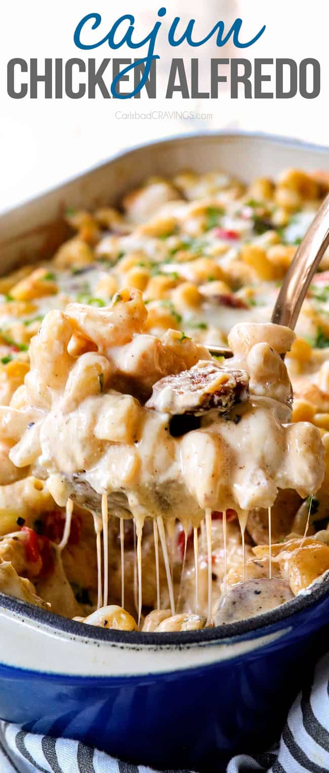 up close of a a spoonful of Cajun Chicken Alfredo showing how cheesy it is
