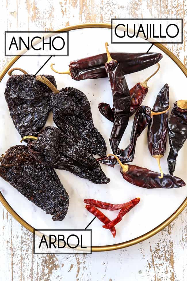 showing how to make birria recipe by showing what ancho, guajillo and arbol chilies look