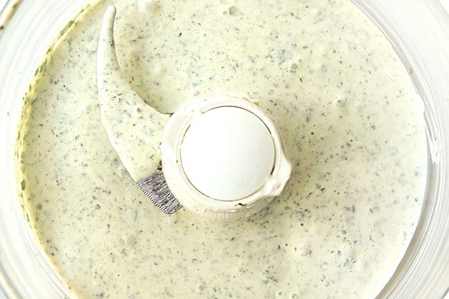 showing how to make rice bowl by making cilantro yogurt sauce in food processor