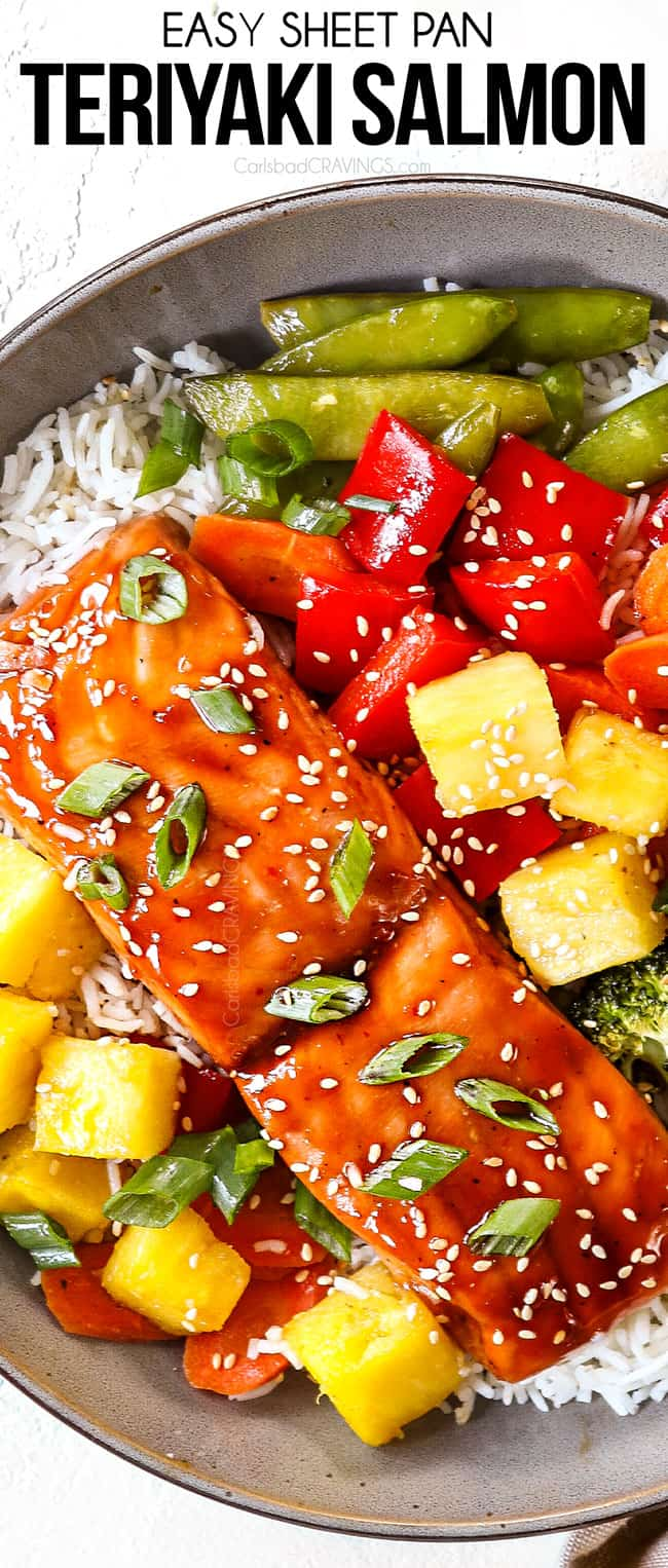 top view of teriyaki salmon in a bowl with pineapple, bell peppers and broccoli