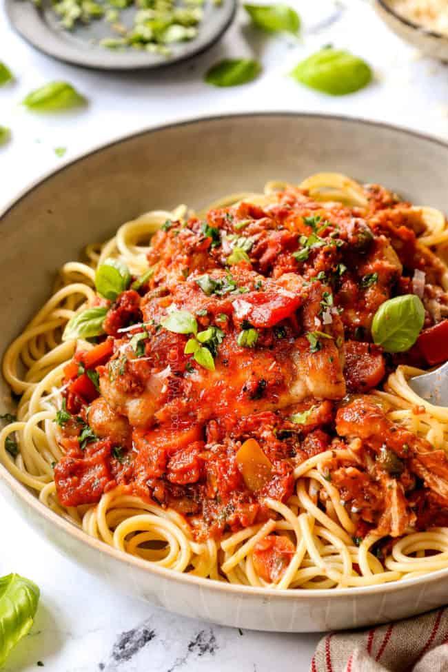 chicken cacciatore recipe in a bowl over pasta