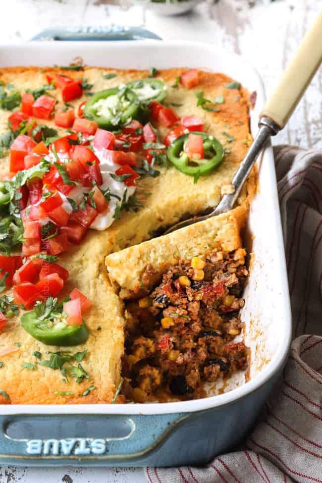 up close of a spoonful of tamale pie with corn, tomatoes and black beans