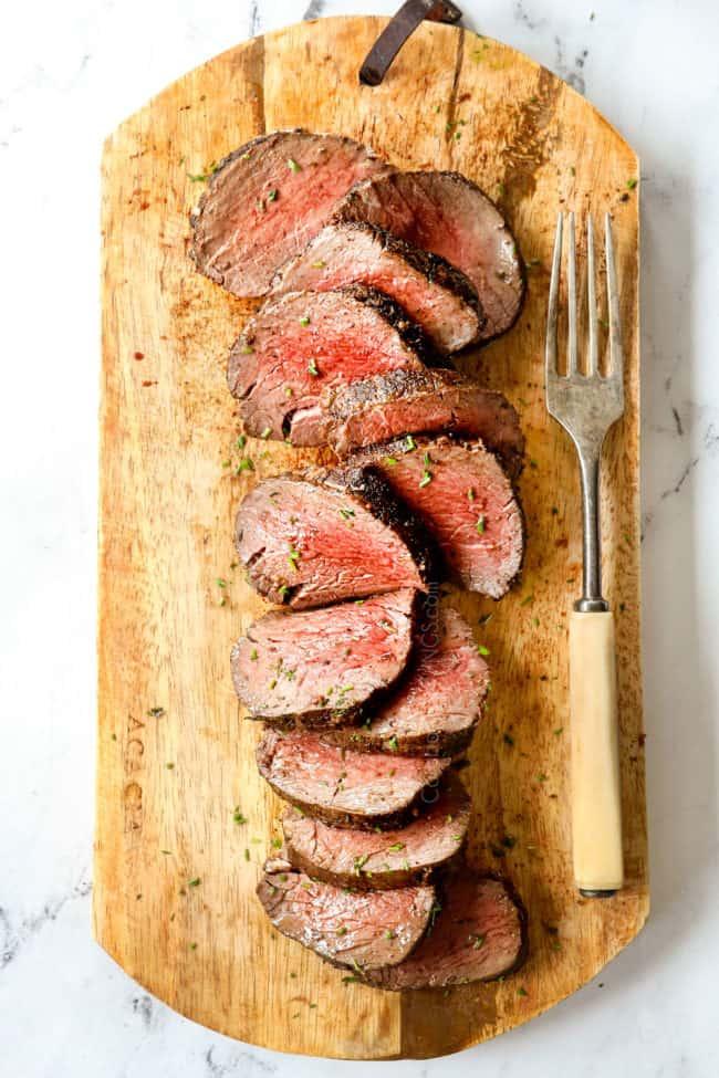 top view of a beef tenderloin roast on a wood cutting board