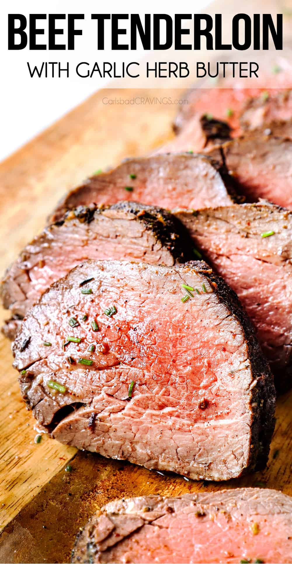 up close of beef tenderloin sliced in a wood cutting board