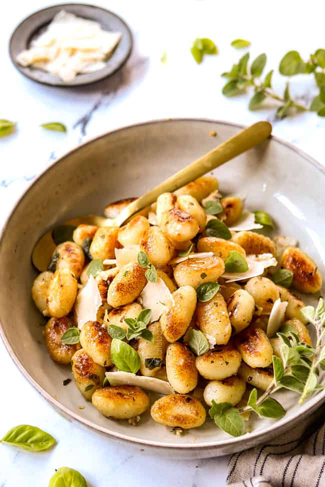gnocchi with sauce in a bowl with sage