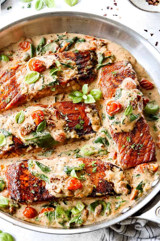 Tuscan salmon recipe with sun-dried tomato cream sauce with tomatoes