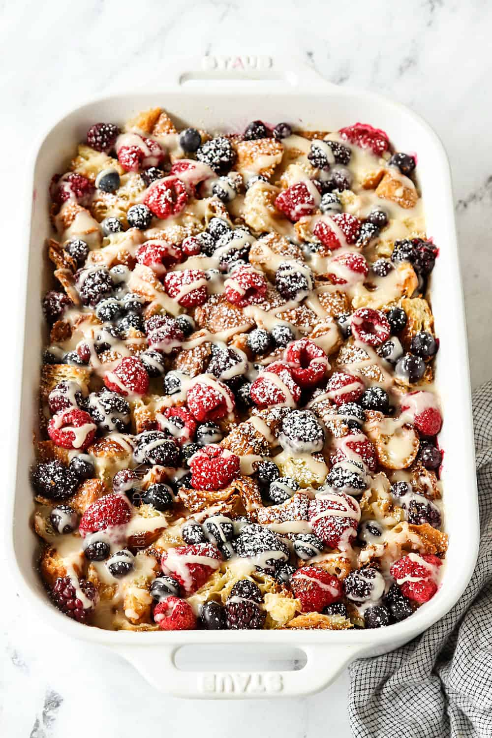 overnight breakfast casserole with croissants in a 9x13 casserole dish