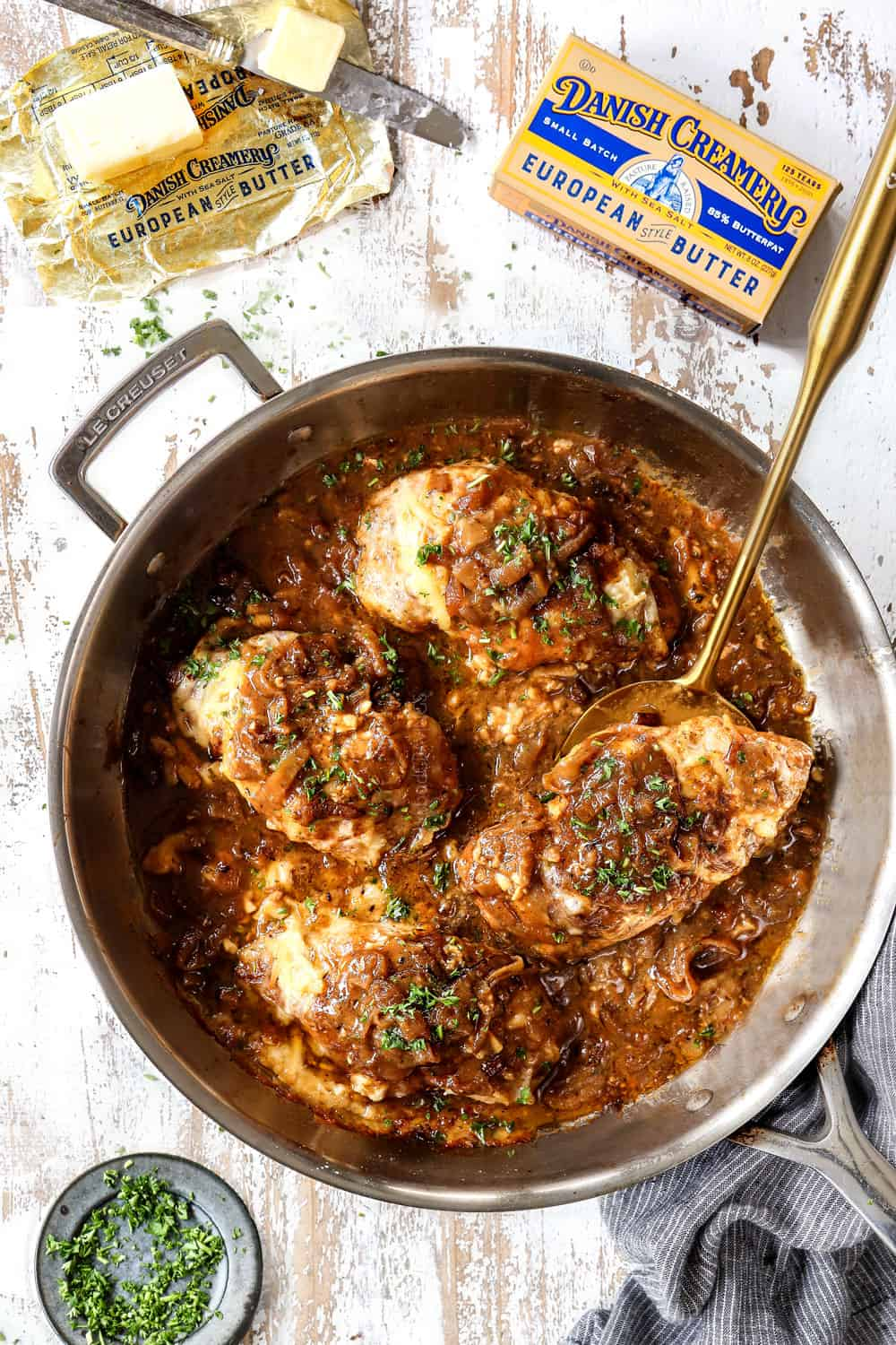 top view of French onion chicken in a skillet with chicken and Gruyere cheese