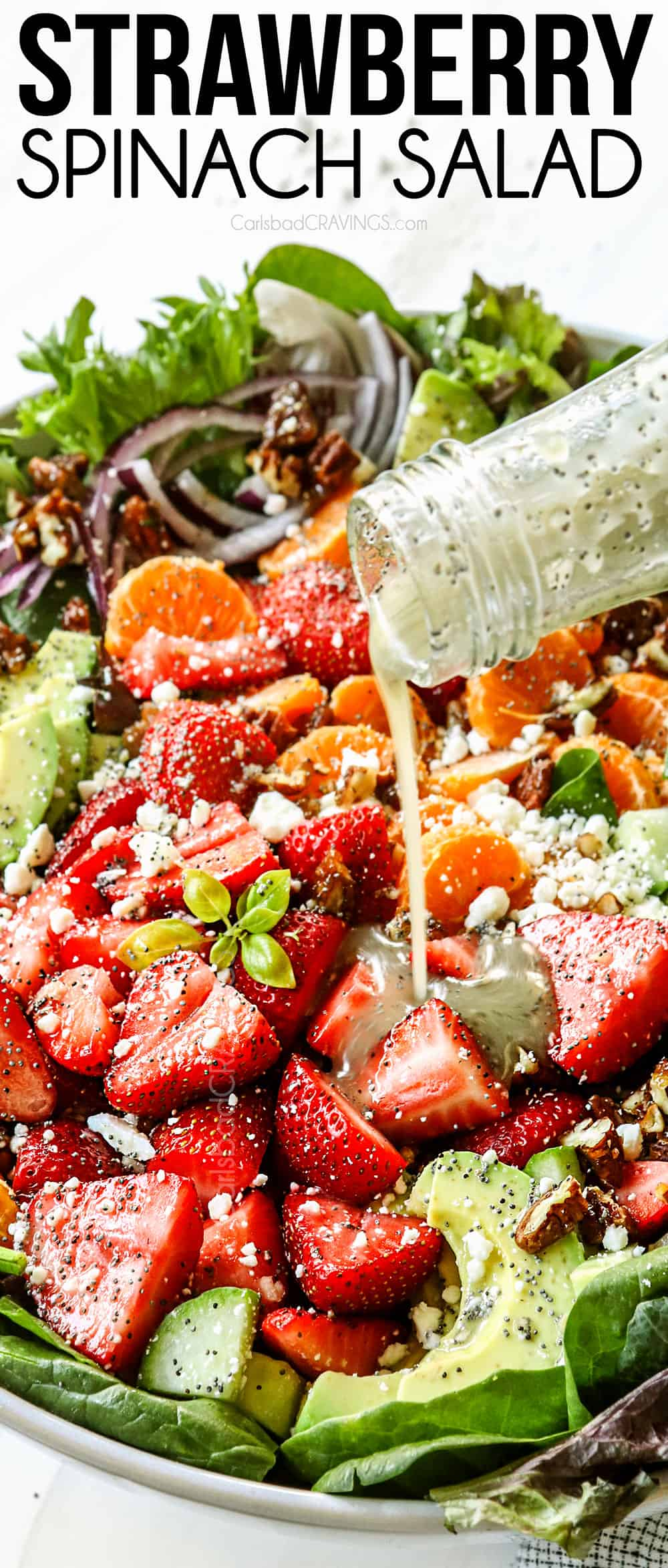 showing how to make strawberry spinach salad by drizzling with strawberry spinach salad dressing