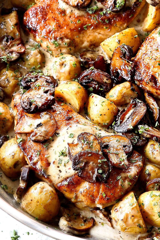 up close of mushroom chicken in a skillet with mushroom cream sauce
