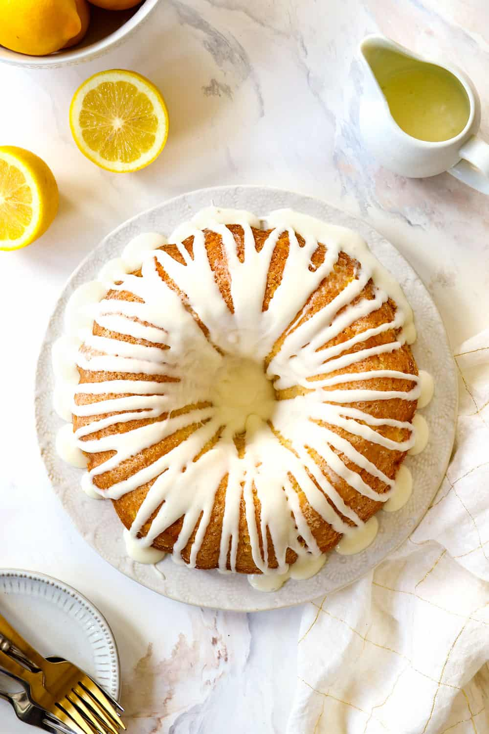 top view of lemon pound cake recipe on a white plate with lemon glaze for cake