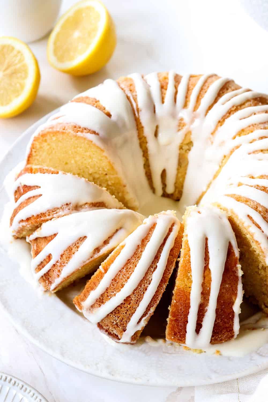 lemon pound cake on a platter sliced  with lemon glaze for cake