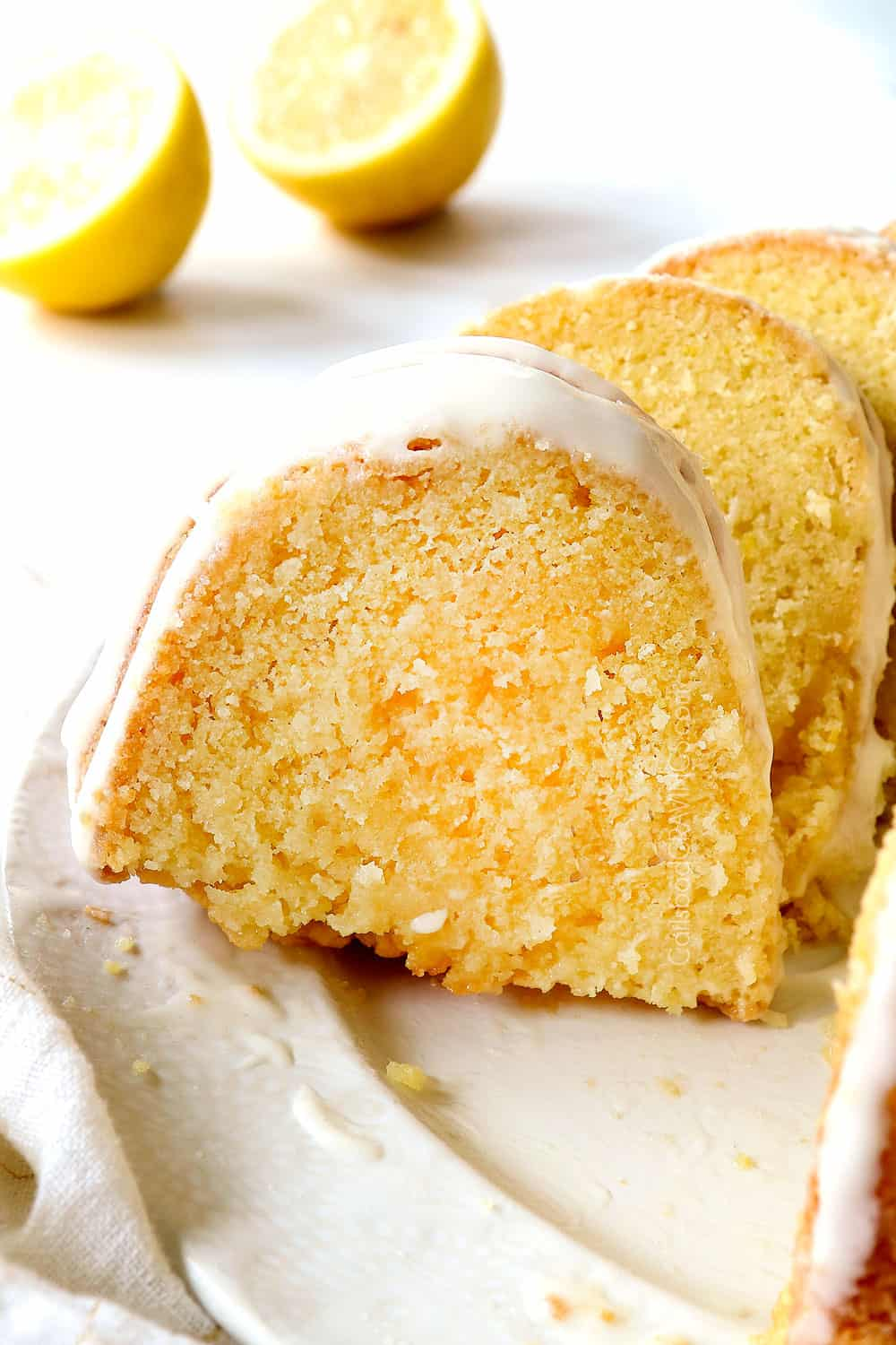 up close of a slice of lemon pound cake recipe showing how moist it is