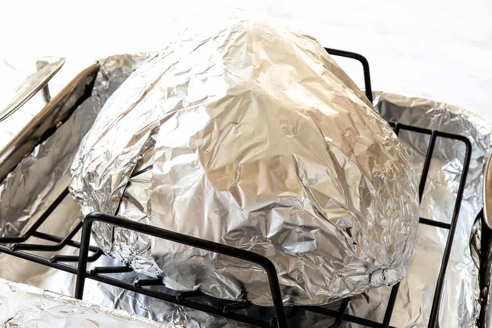 showing how to make spiral ham by wrapping spiral ham with foil and placing in a roasting pan