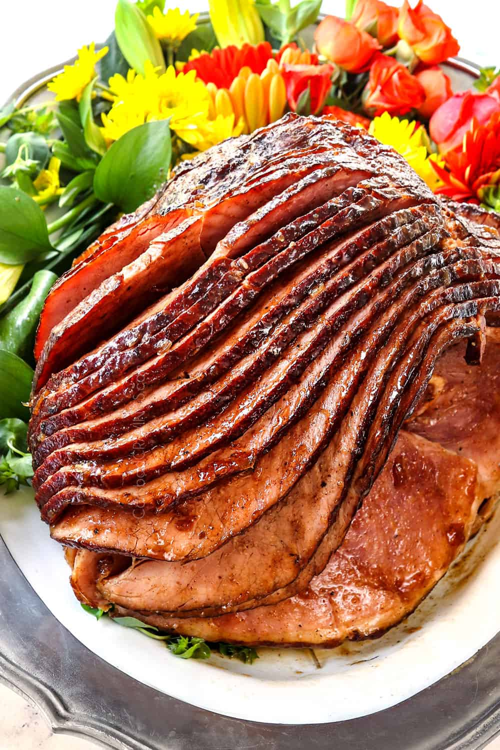 showing how to make ham glaze recipe with brown sugar and pineapple by letting the ham rest on a platter after baking