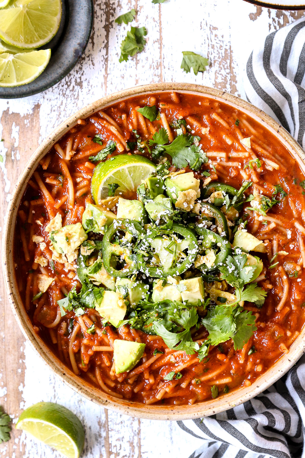 top view fideo soup in a bowl with cilantro and jalapenos