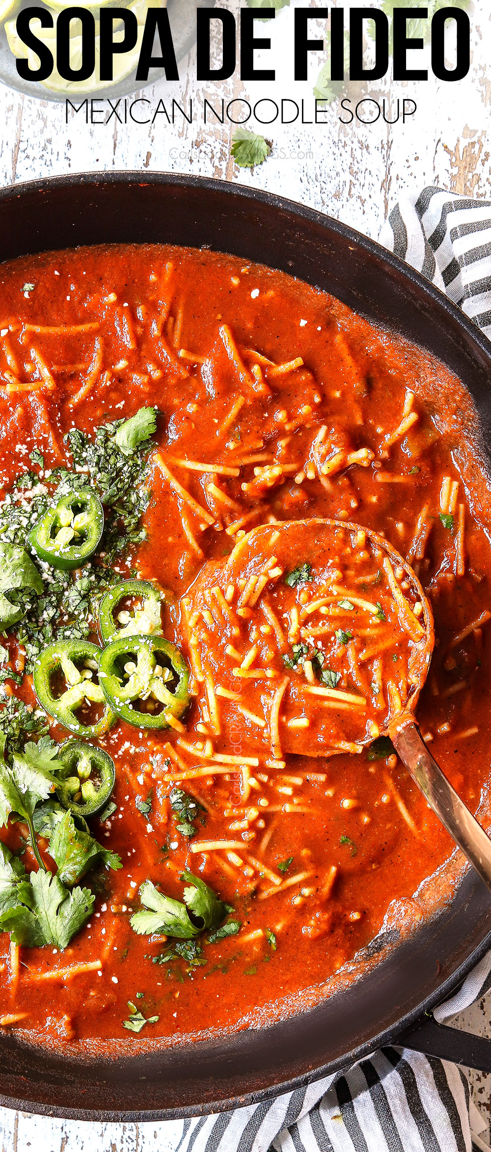 top view of sopa de fideo with a ladle