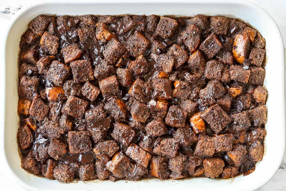showing how to make bread pudding by baking until set in a 9x13 baking dish