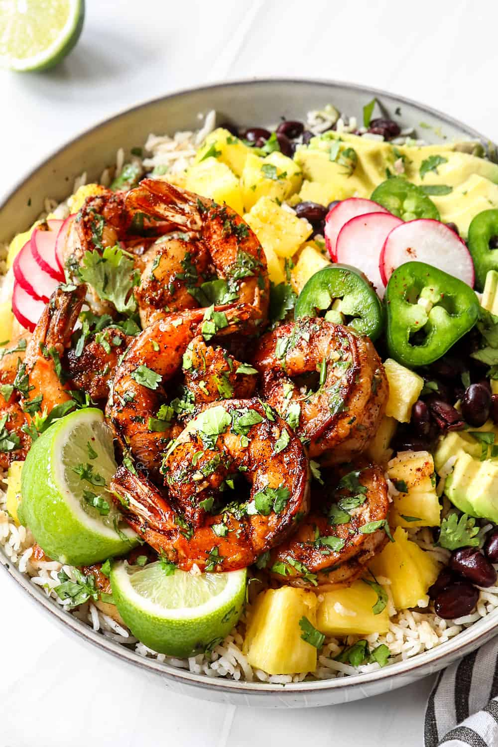 cilantro lime shrimp in a bowl garnished with cilantro and lime