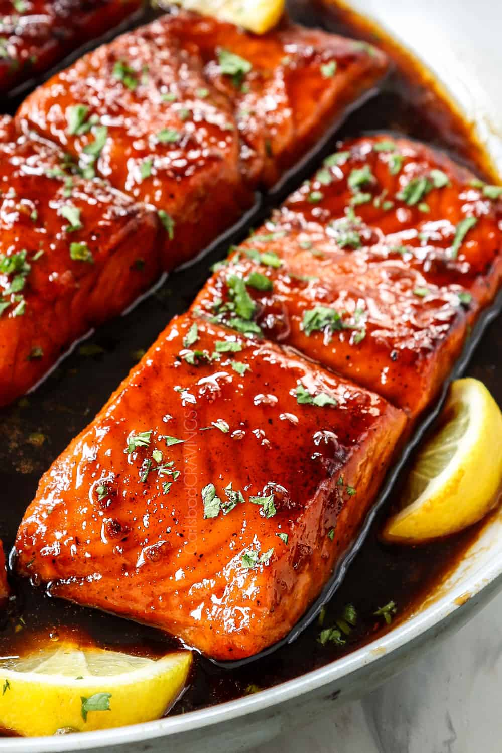 up close of honey garlic glazed salmon showing how juicy it is
