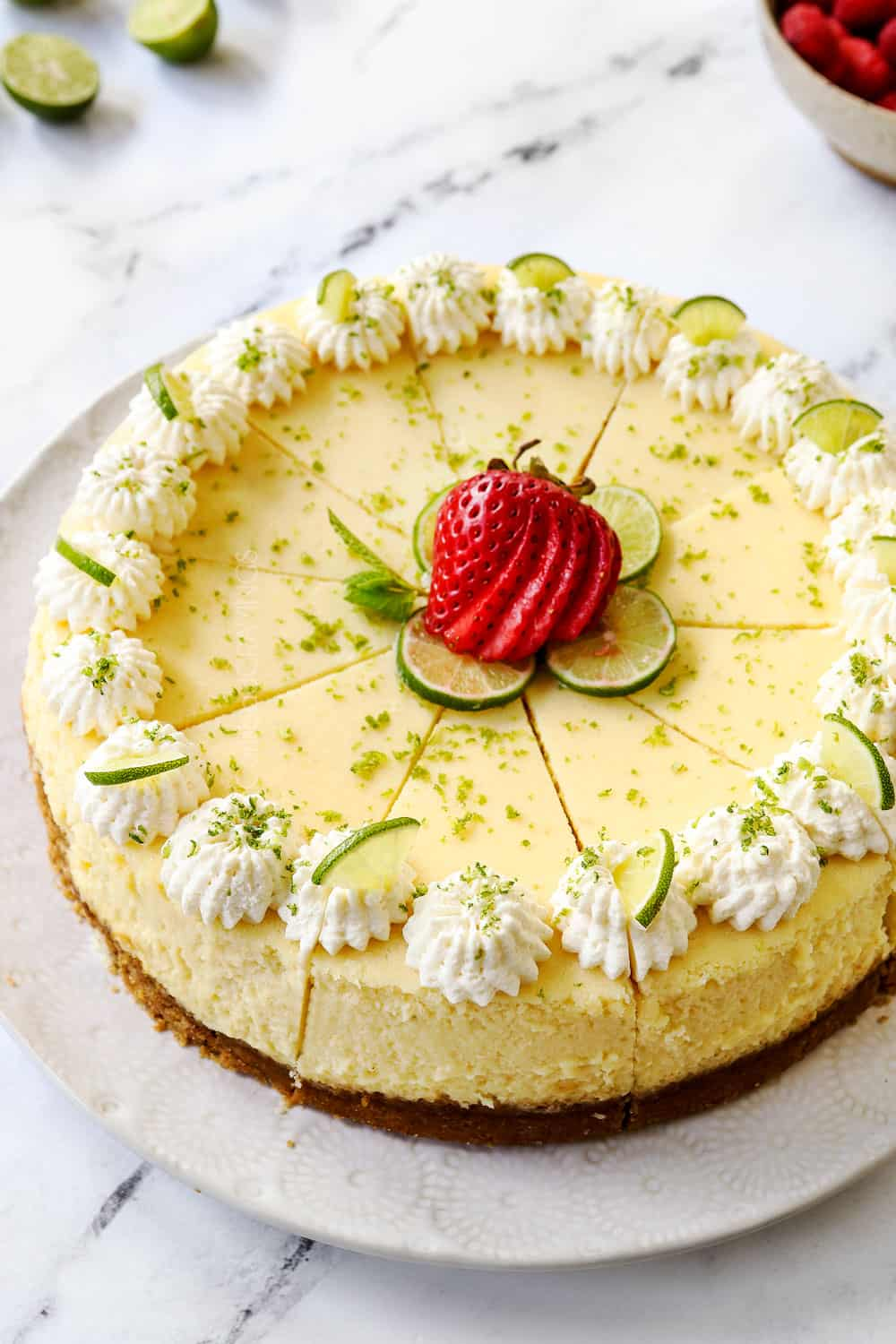 showing how to make key lime cheesecake by slicing into even pieces