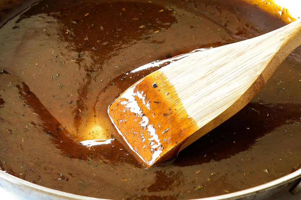 showing how to make Brown Sugar Chicken by simmering brown sugar sauce until thickened