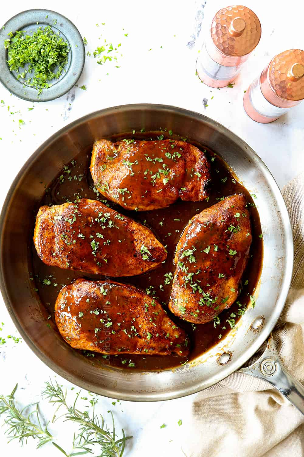 up close top view of brown sugar chicken recipe garnished with parsley