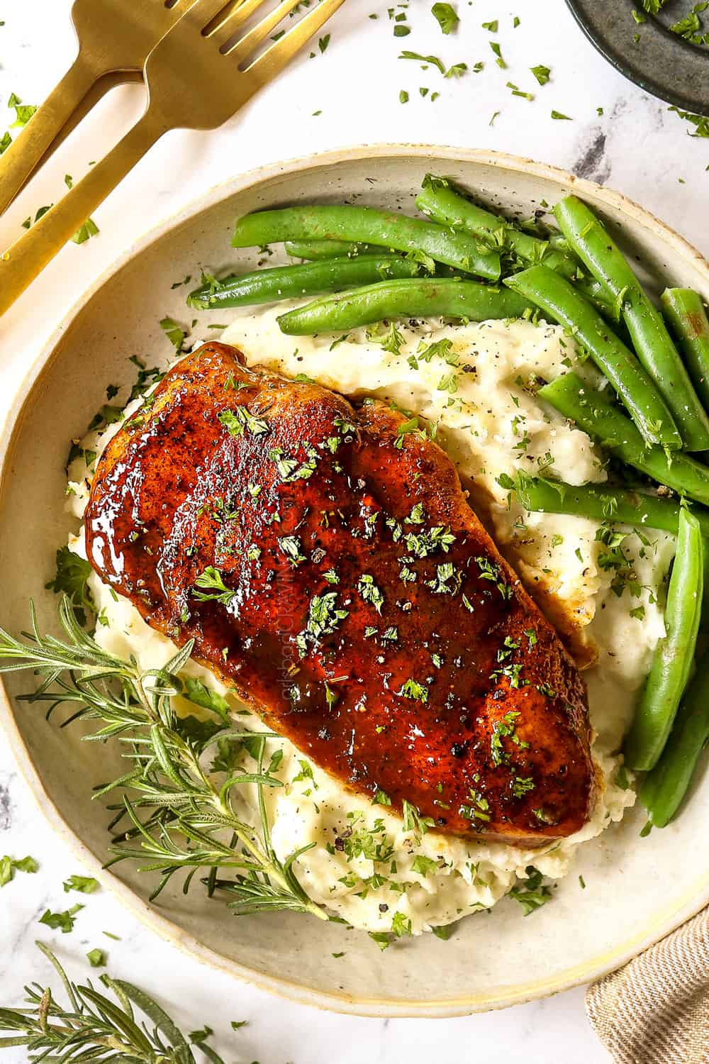 showing how to serve garlic brown sugar chicken with a top view of the chicken with mashed potatoes and green beans