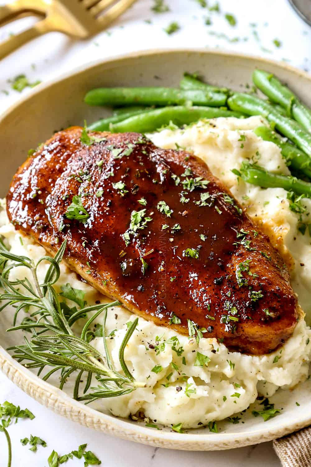 showing how to serve garlic brown sugar chicken with a side view of the chicken with mashed potatoes and green beans