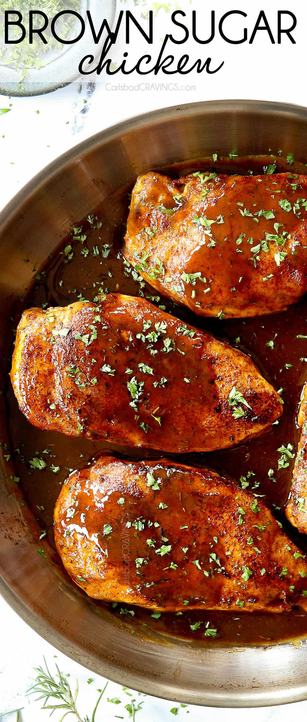 up close top view of garlic brown sugar chicken in a stainless steel skillet