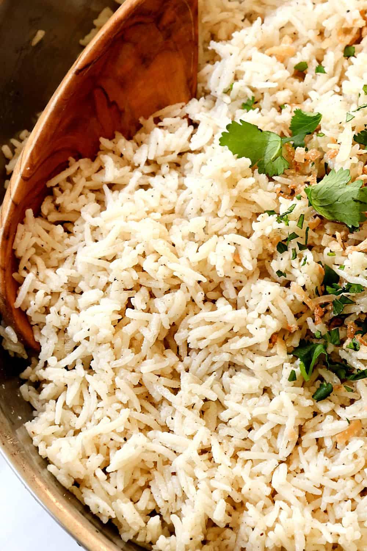 up close of spooning coconut jasmine rice
