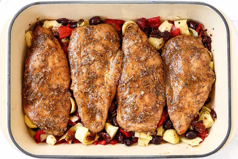 showing how to make Greek chicken by adding Greek chicken to baking dish