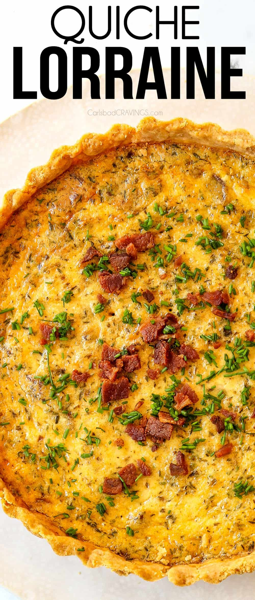 top view of Quiche Lorraine garnished with bacon and chives on a white plate