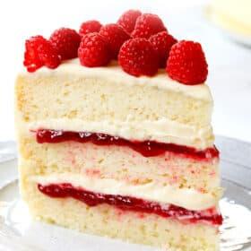 a slice of white chocolate raspberry cake on a plate