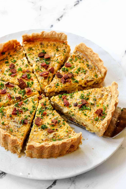 best Quiche Lorraine recipe sliced on a white plate
