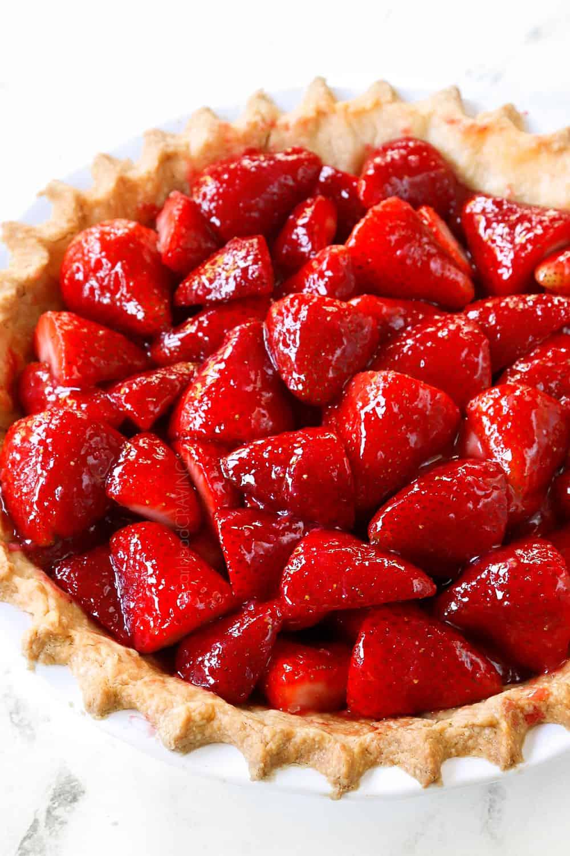side view of strawberry pie recipe in a pie crust