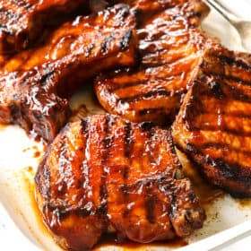 up close of grilled pork chops recipe showing how juicy they are
