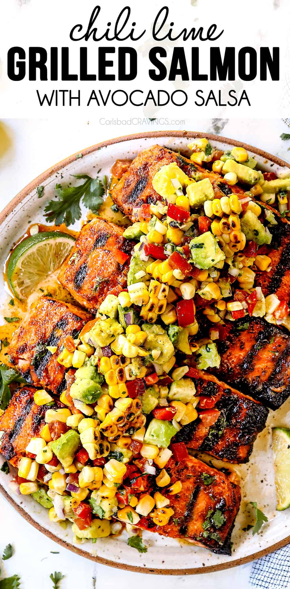 top view of grilled salmon on a plate with avocado corn salsa