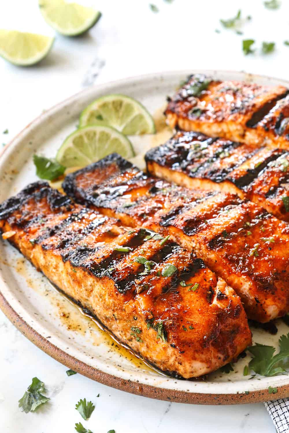 up close of a fillet of grilled salmon showing how juicy it is